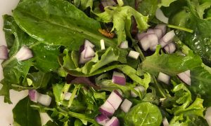 Greens, olive oil, sea salt, pepper, and red onions